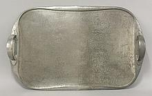 A Tudric pewter tray,   stamped 'Tudric English Pewter, Liberty & Co. 043',  47cm long