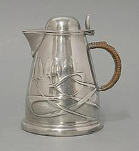A Tudric pewter lidded jug,   moulded with entwined motifs, stamped 'English Pewter 0958',