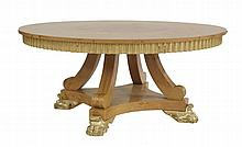 A David Linley burr oak and walnut dining table,  the circular top raised on a gilt frieze with