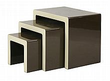 A nest of three tables,  1970s, in two-tone cream and brown,  60cm wide  40cm deep