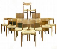 A Danish teak dining room suite,   comprising:   a set of four dining chairs,   designed