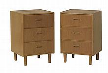 A pair of oak bedside cupboards,  raised on turned legs,  41cm wide  38cm deep  61.5