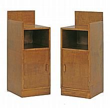 A pair of Art Deco sycamore bedside cupboards,  with a high back, a shelf over a cupboard, on a
