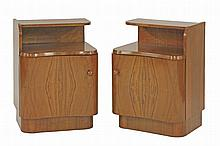 A pair of walnut kidney-fronted bedside cabinets,  with a shelf over a cupboard,  43.5cm wid