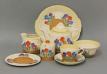 A Royal Staffordshire Clarice Cliff Honey Glaze 'Spring Crocus' tea set, comprising:  six cups,