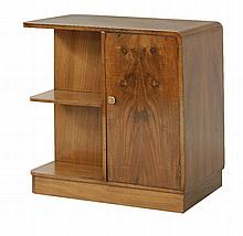 An Art Deco walnut cabinet,  with a cupboard opposite shelves, on a plinth and castors, labelled
