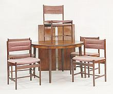 A Danish rosewood circular dining table,  1960s, with two extra leaves, on turned supports,