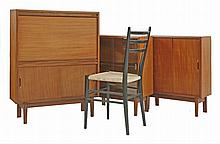 A teak bureau,   designed by Robert Heritage for Tapley and Beaver, with a fall front enclosing