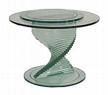 A modern glass occasional table,  the circular top raised on a 'staircase' stepped plinth, revol