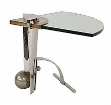 A polished steel occasional table,  with a wedge-shaped glass shelf, signed,  85cm wide