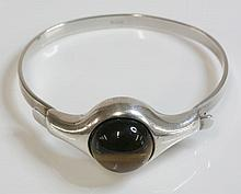 A Norwegian modernist silver tiger's eye bangle, c.1970,  by A Holthe of Arandel, a circular cab
