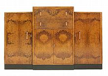 An Art Deco burr walnut dining room suite,  comprising:  a dining table,  raised on two