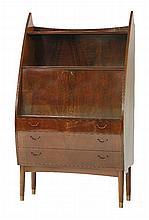 A Danish walnut bureau,  of teardrop shape, the drop-down writing surface enclosing a mirrored i