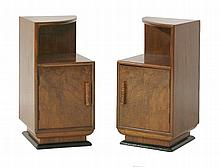 A pair of walnut pot cupboards,  a quarter cut top over a shelf with a cupboard below, with carv