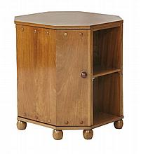 An Art Deco walnut octagonal drinks cabinet,  with two cupboards with glass and bottle carriers,