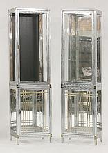 A pair of chrome and glazed two-tier cabinets,  in two parts, lacking glass shelves, and  on
