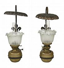A pair of Arts and Crafts wrought iron, brass and copper oil lamps,  with etched shades, a sinuo