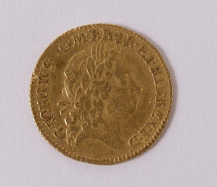 A George I gold half guinea, 1718, sceptres in