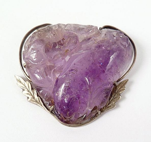 An Arts and Crafts carved amethyst brooch, c.1920,