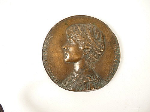 A bronze portrait medallion, of Marie Stillman,