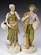 A pair of Royal Dux rustic figures, pad and printed marks to base, impressed 2445 and 2446, 32.5 and 32cm high