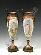 A pair of Sèvres-style vases, c. 1890, each with gilt bronze mounts and handles, printed and painted with female figures, signed, the backs with gilt ribbon and torch decoration, 43cm
