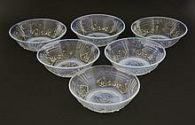 A set of six Jobling opalescent glass dishes, c