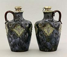 A pair of Royal Doulton stoneware flasks, with