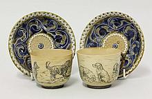 A pair of Doulton Lambeth stoneware cups and
