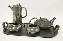 A Tudric pewter four-piece tea set, designed by