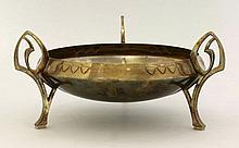 A WMF silver-plated bowl, raised on three pierced