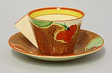 A Clarice Cliff 'Nasturtium' breakfast cup and