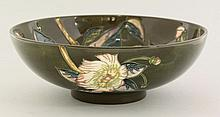 A Moorcroft bowl, 2000, with a flower to the