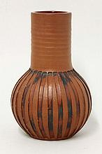 A Poole Pottery red earthenware vase, by Guy