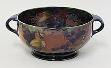 A Moorcroft 'Pomegranate' fruit bowl, with twin