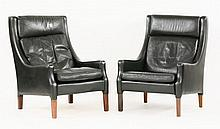 Two Danish black leather armchairs, with matched