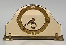 An Art Deco pink tinted glass strut clock, with a
