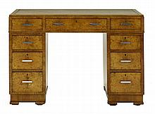 An Art Deco burr walnut desk, the leather top over