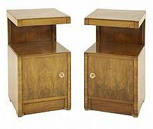 A pair of walnut bedside cabinets, with inverted