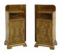 A pair of walnut bedside cupboards, each with