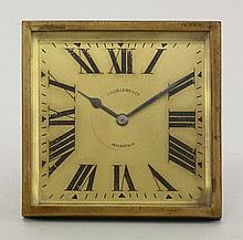 A gilt table clock, the square dial with Roman