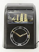 A Vitascope Bakelite clock, in black with an
