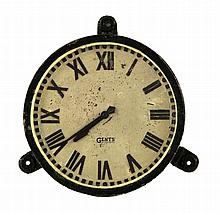A cast iron electric wall clock, the circular dial