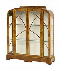 A walnut display cabinet, of stepped form with