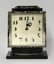 An Art Deco marble mantel clock, the silvered dial