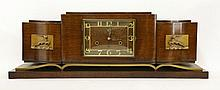 An Art Deco walnut and parcel-gilt mantel clock,