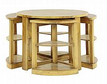 An Art Deco walnut nest of tables, the circular