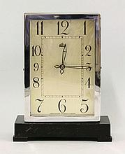 A Bulle electric mantel clock, the oak and