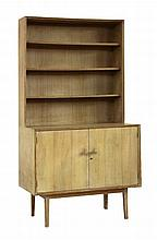 A limed oak bookcase cabinet, with chamfered