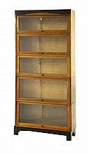 An Art Deco oak five-tier glazed bookcase, with